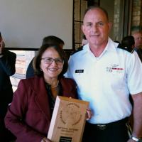 Congresswoman Jo Mores with a plaque  received from CAPSTONE Group.