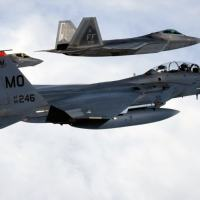Forth Generation F-15 fighter flying together with fifth generation  F-22 Raptor and F-35 Lightning II  Photo - USAF