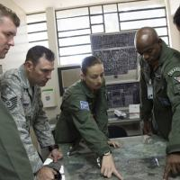 Members of the Brazilian Air Force point out specific landing zones for their aircraft during a tour on their squadron during a week-long exchange focused on enhancing Search and Rescue, May 15, 2015 in Campo Grande, Brazil. (U.S. Air Force photo by Staff Sgt. Adam Grant)